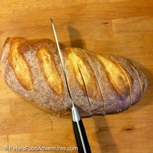 Easy Cheesy Garlic Pull-Apart Bread cutting diagonally