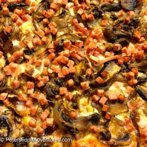 Making this bread maker pizza dough recipe will save your time and money, and provide you with better tasting pizzas - Caramelized Onion, Mushroom and Bacon Pizza from Scratch