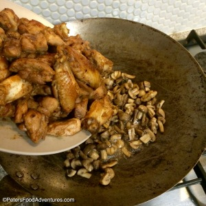 Chicken Wing and Mushroom Stir Fry in a Wok