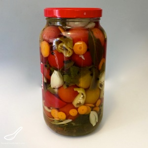 Enjoy your fresh, local tomatoes by preserving them Russian-style. Pickled with garlic and herbs, these canned tomatoes are a staple year round - Russian Pickled Tomatoes (солёные помидоры)
