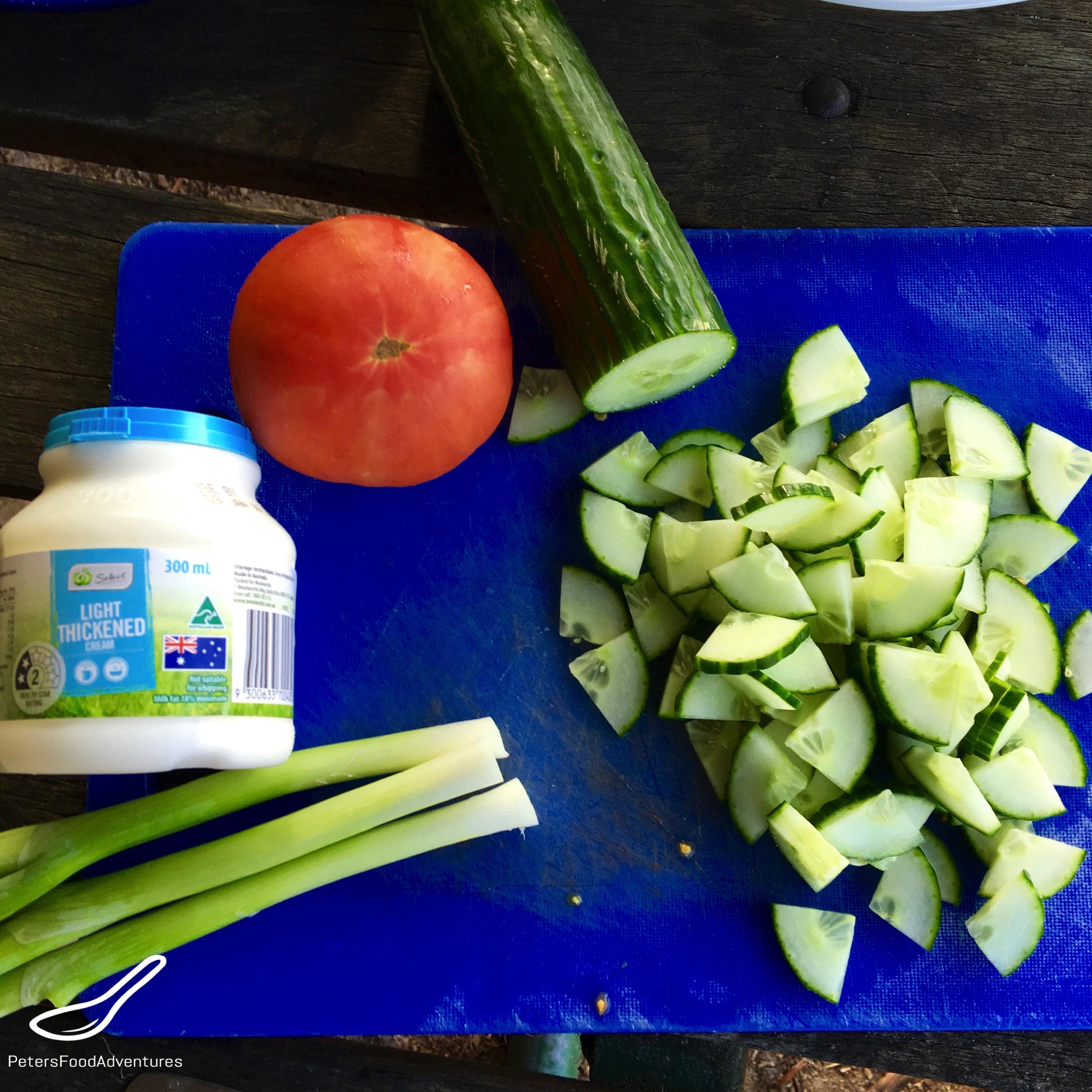 Chopping Cucumbers on Cutting Board